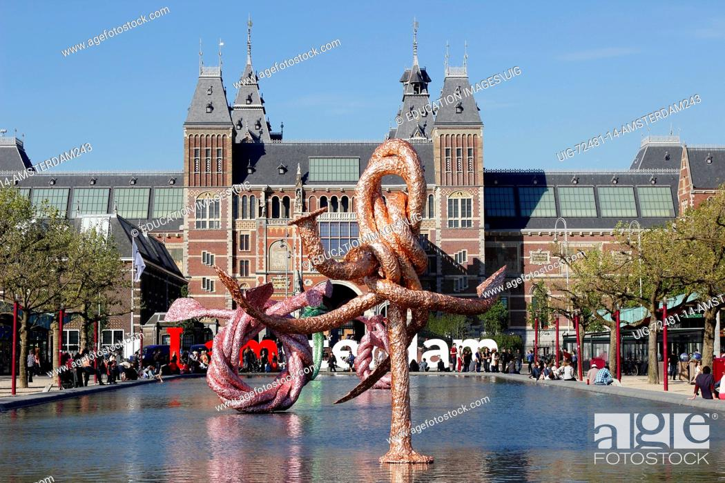 amsterdam, sculpture in reflecting pool in front of rijksmuseum with