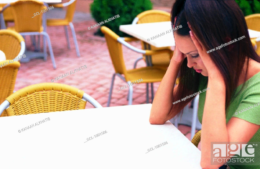 Stock Photo: Woman waiting in a cafe.