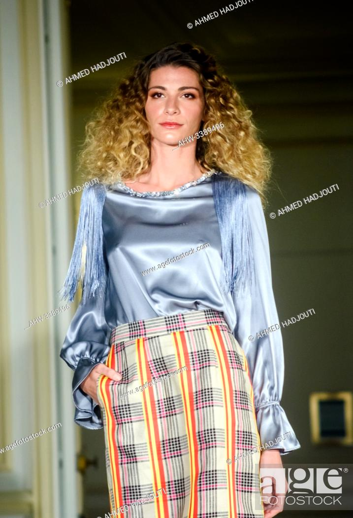 Stock Photo: PARIS, FRANCE - SEPTEMBER 28: A model walks the runway during the Alianna Liu Womenswear Spring/Summer 2020 show as part of Paris Fashion Week on September 28.