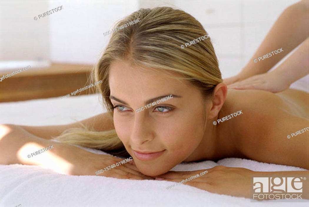 Stock Photo: Close-up of a young woman getting a back massage.