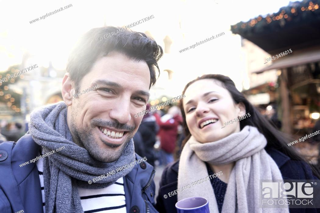 Stock Photo: couple at christmas market in Munich, Germany.