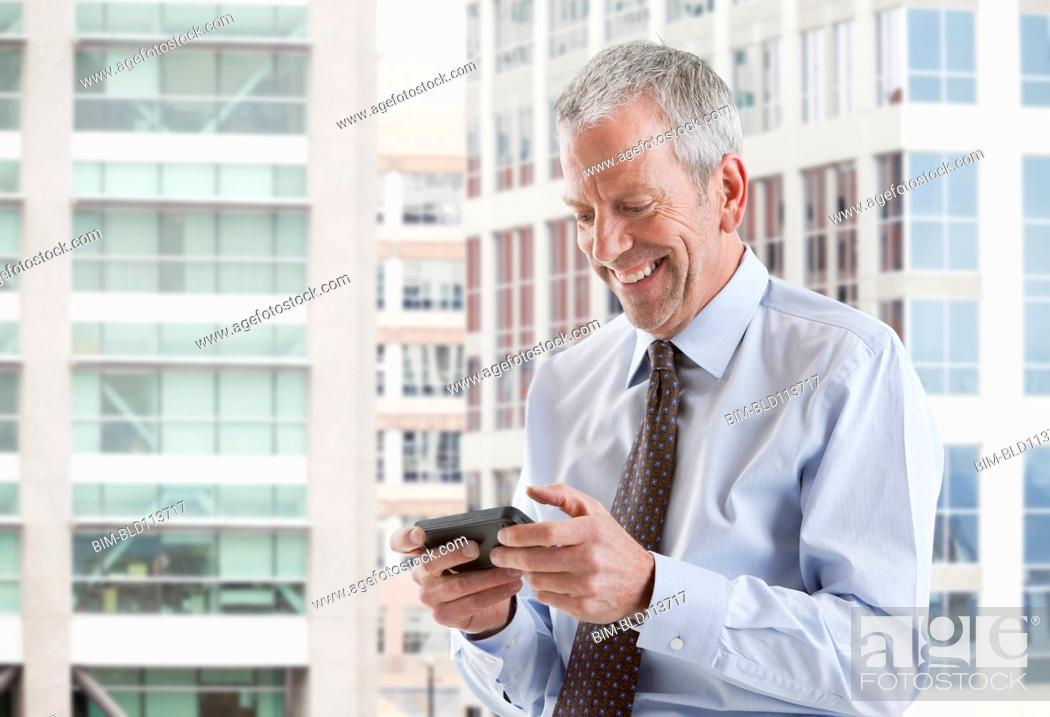 Stock Photo: Caucasian businessman using cell phone.