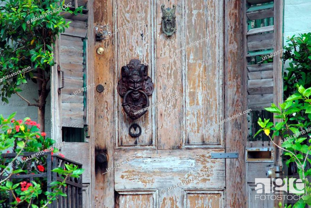 Stock Photo: Antique old door at the Marigny Faubourg neighborhood, New Orleans, Louisiana, USA.