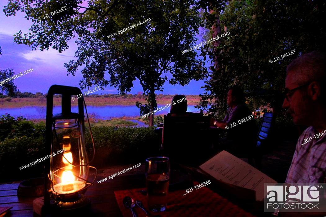 Stock Photo: Sunset on the Okavango river at 'Crocodile Lodge', Maun, Botswana.
