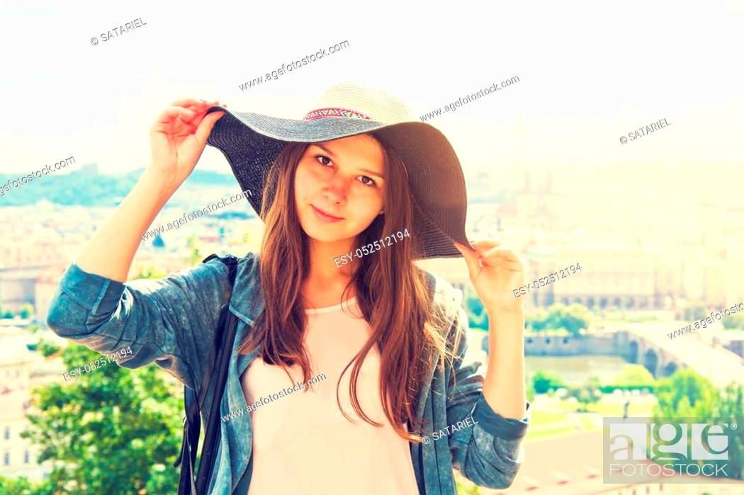 Stock Photo: Beautiful charming tourist girl with hat on her head. Tourism concept. Retro vintage picture.