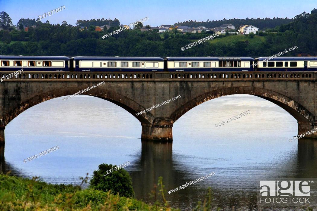 Stock Photo: Outside of Transcantabrico Gran Lujo luxury train travellong across northern Spain, Europe. Bridge near Viveiro town, Galicia, Spain.
