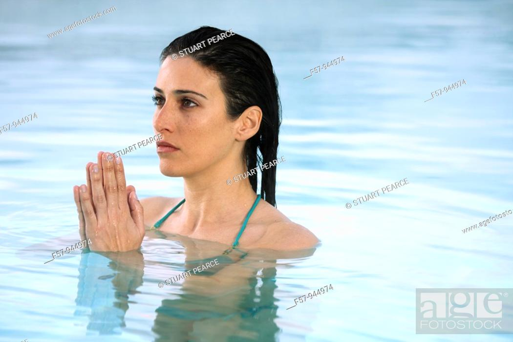 Stock Photo: Woman in water, hands clasped.