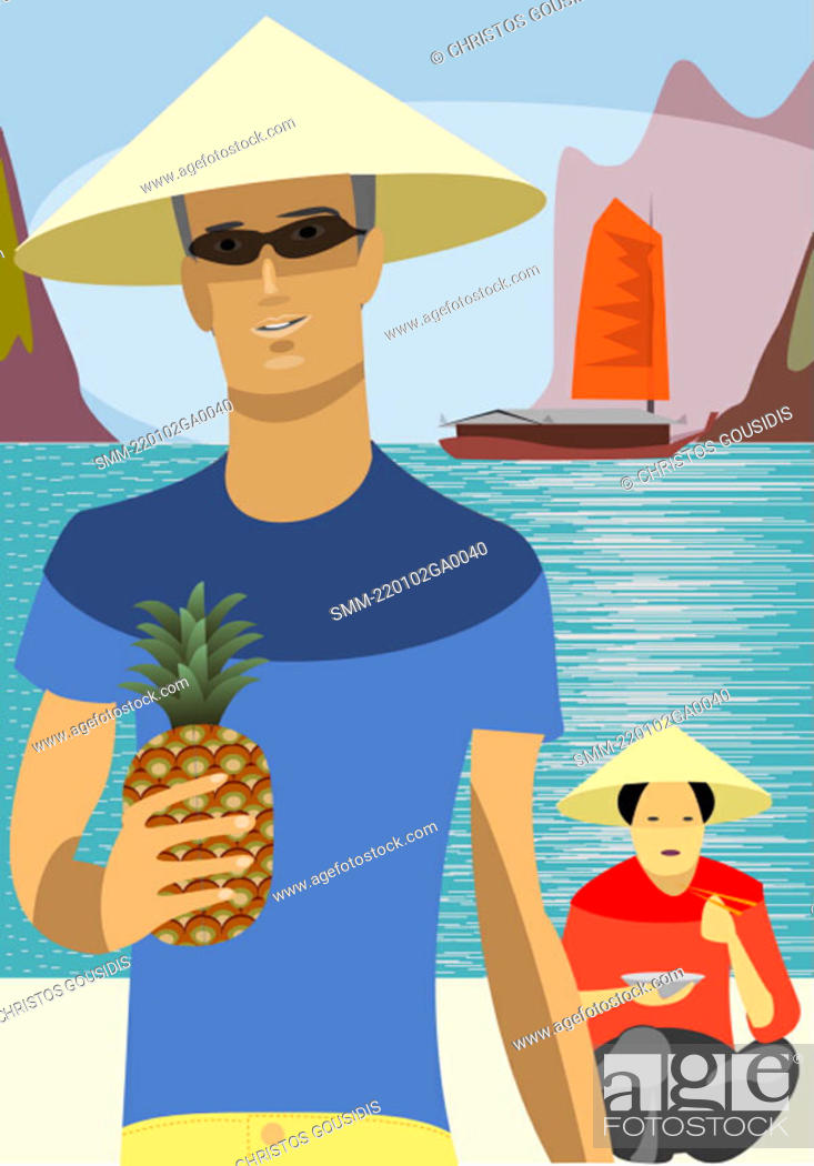 Stock Photo: Young man wearing Asian hat on the beach with Asian woman in background.