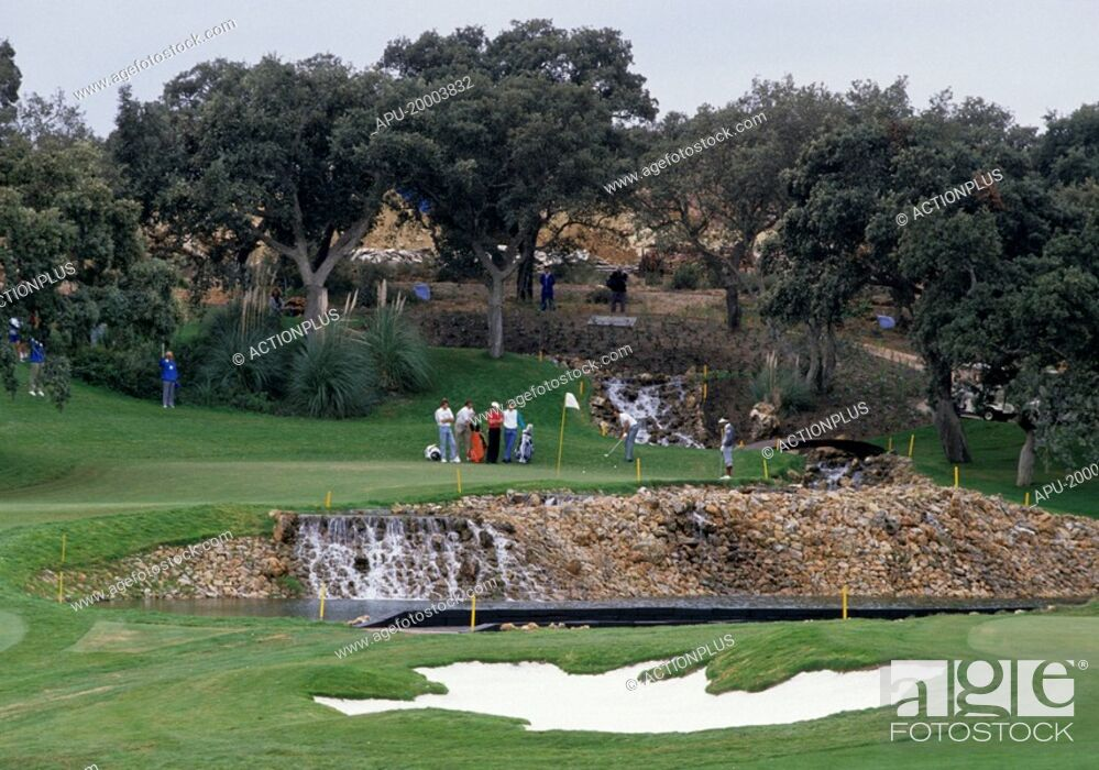 Stock Photo: Golfers on a golf course.
