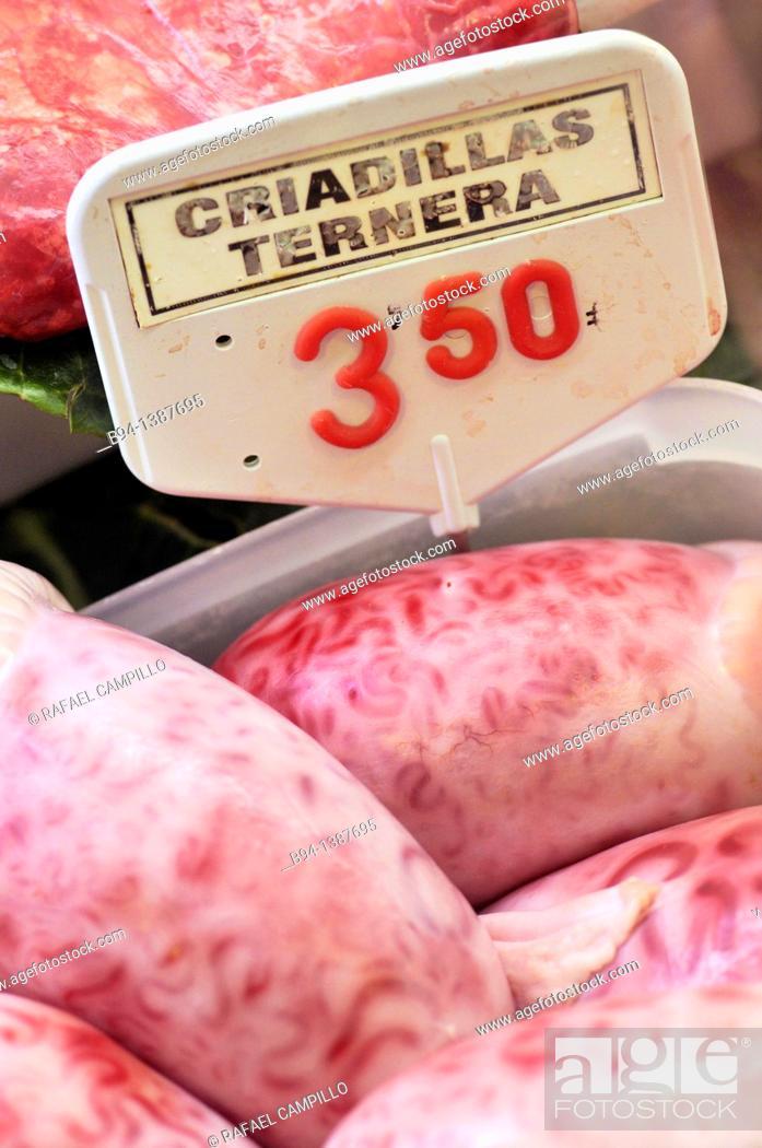 Stock Photo: Raw bovine testicles in La Boqueria market, Barcelona. Catalonia, Spain.