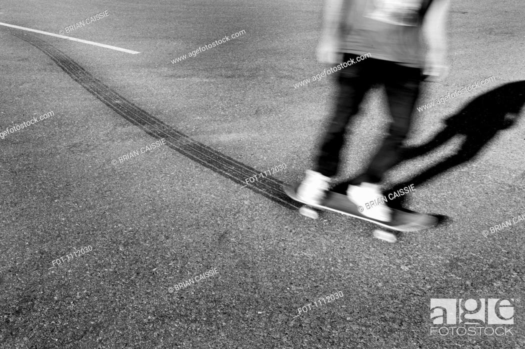 Stock Photo: A skateboarder leaving tire tracks.