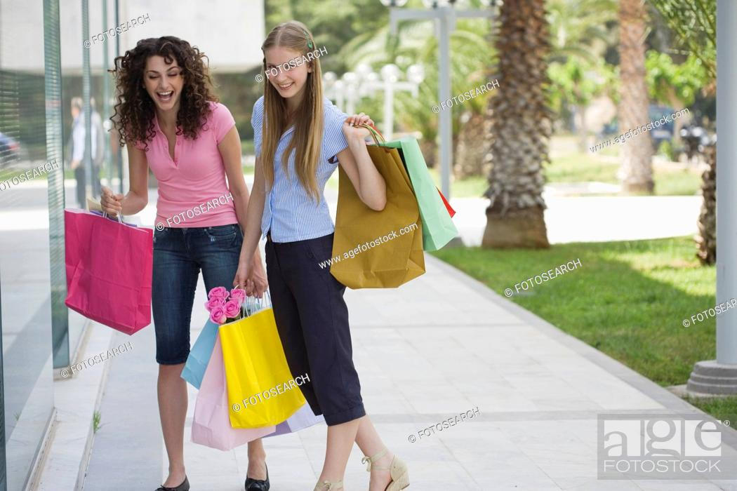 Stock Photo: Two women with shopping bags.