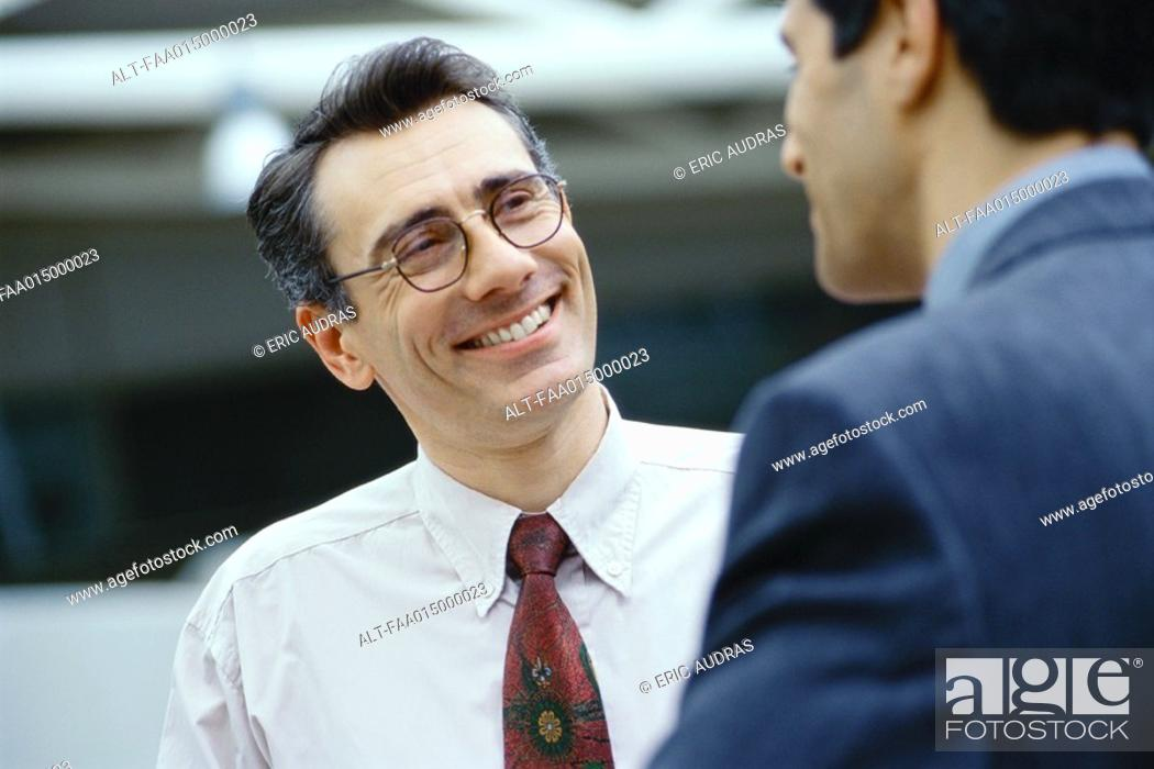 Stock Photo: Businessmen talking face to face, head and shoulders.