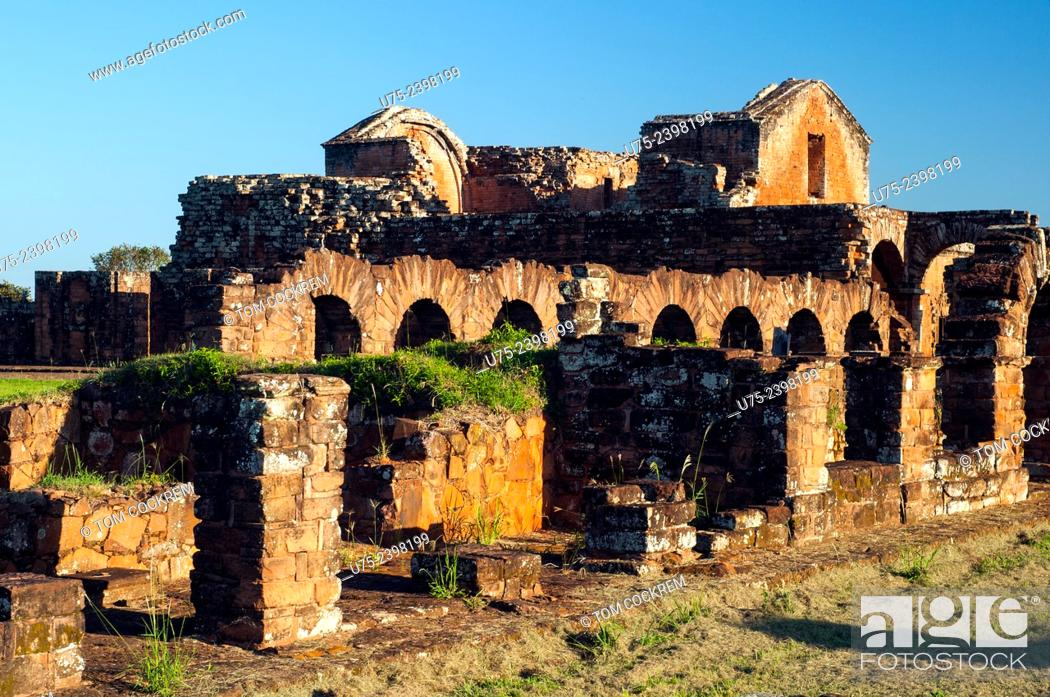 Stock Photo: View of cloister archways and cathedral from the secondary church, Jesuit Mission of La Santísima Trinidad de Paraná ruins, Encarnacion, Paraguay.