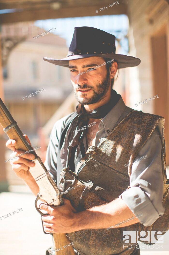 Imagen: Cowboy holding up shotgun on wild west film set, Fort Bravo, Tabernas, Almeria, Spain.