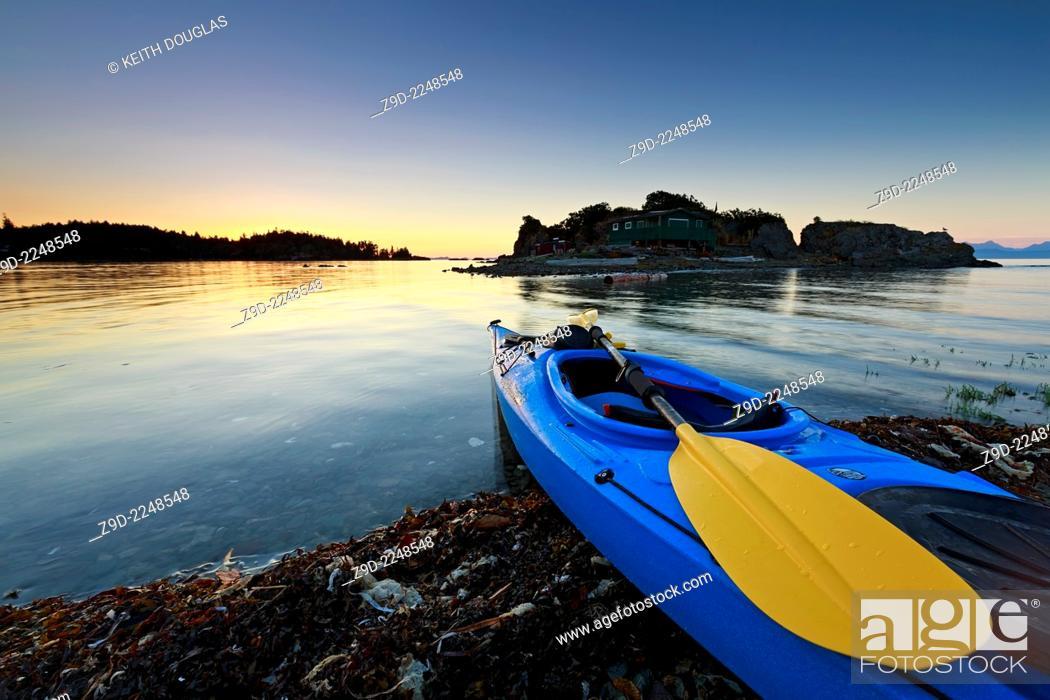 Stock Photo: Sea kayak at sunset, Pipers Lagoon Park, Nanaimo, Vancouver Island, British Columbia.