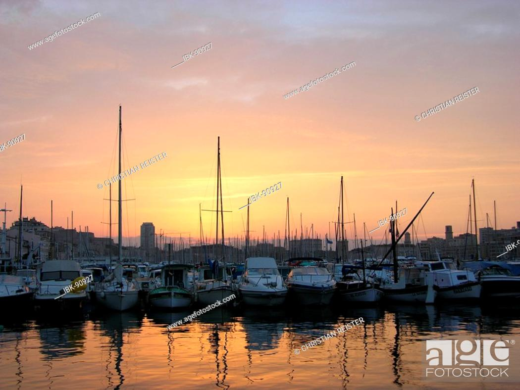 Stock Photo: Sunset and Ships in the Old Harbor in Marseille, France.