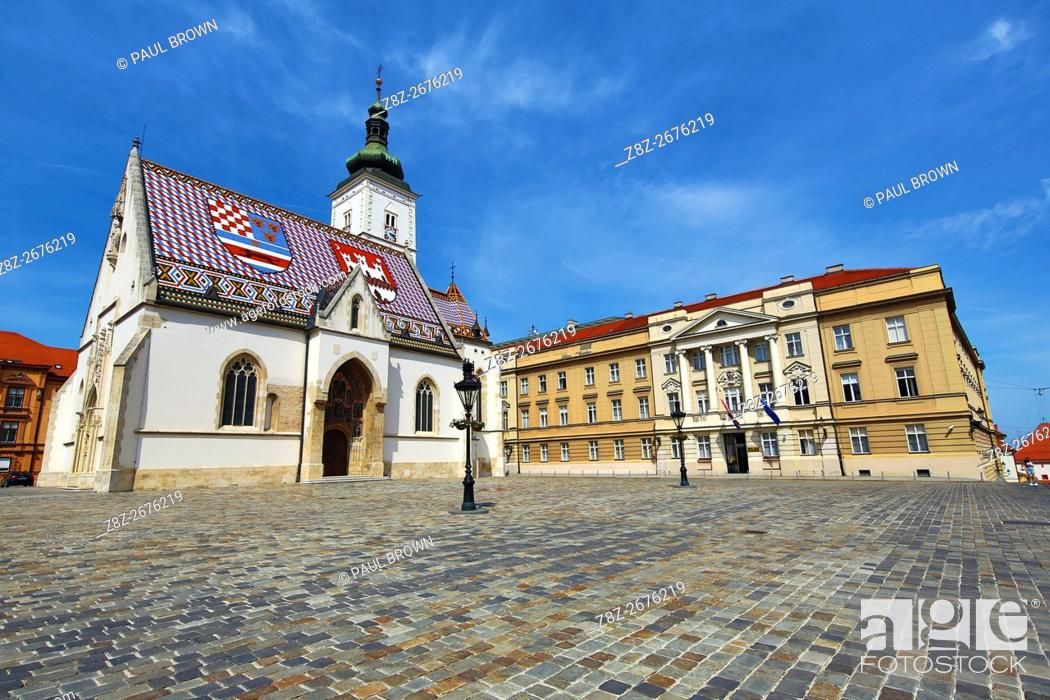 Stock Photo: St. Mark's Church and the Croatian Parliament in St. Mark's Square in Zagreb, Croatia.