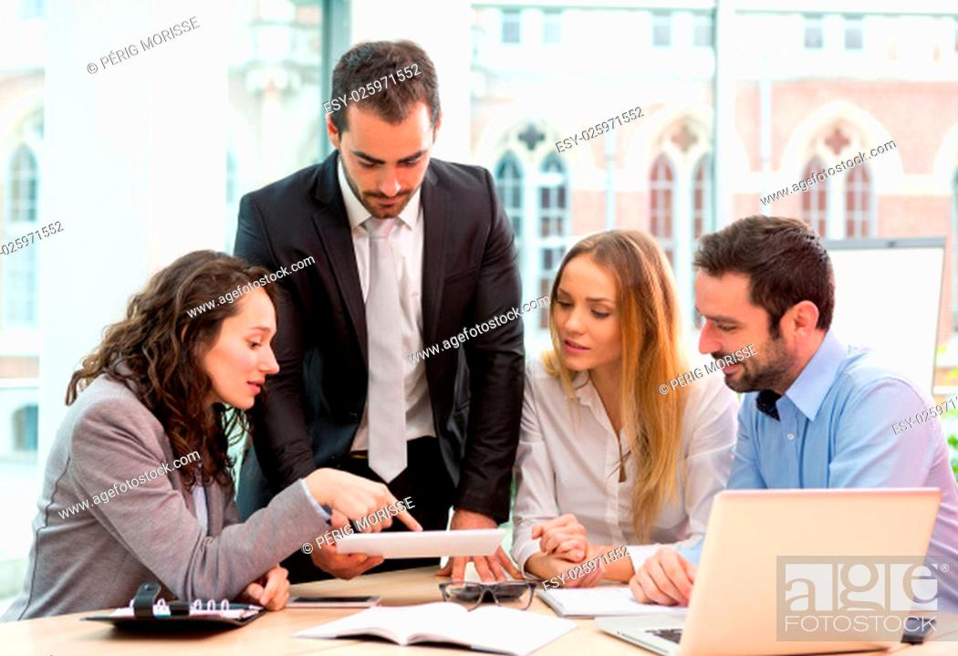 Stock Photo: View of a Group of business people working together at the office.