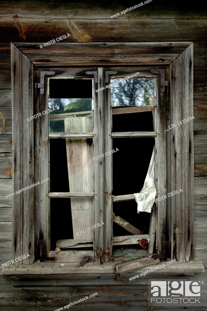 Stock Photo: A window from a old abandoned farm house in Poland.