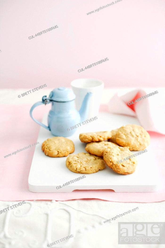 Stock Photo: Plate of cookies with cup of tea.