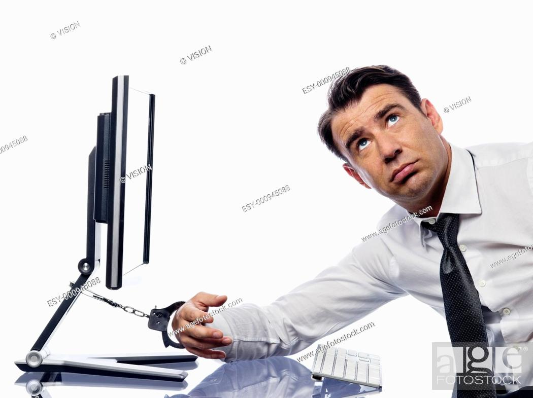 Stock Photo: caucasian man chained to computer with handcuffs expressing addiction concept isolated studio on white background.