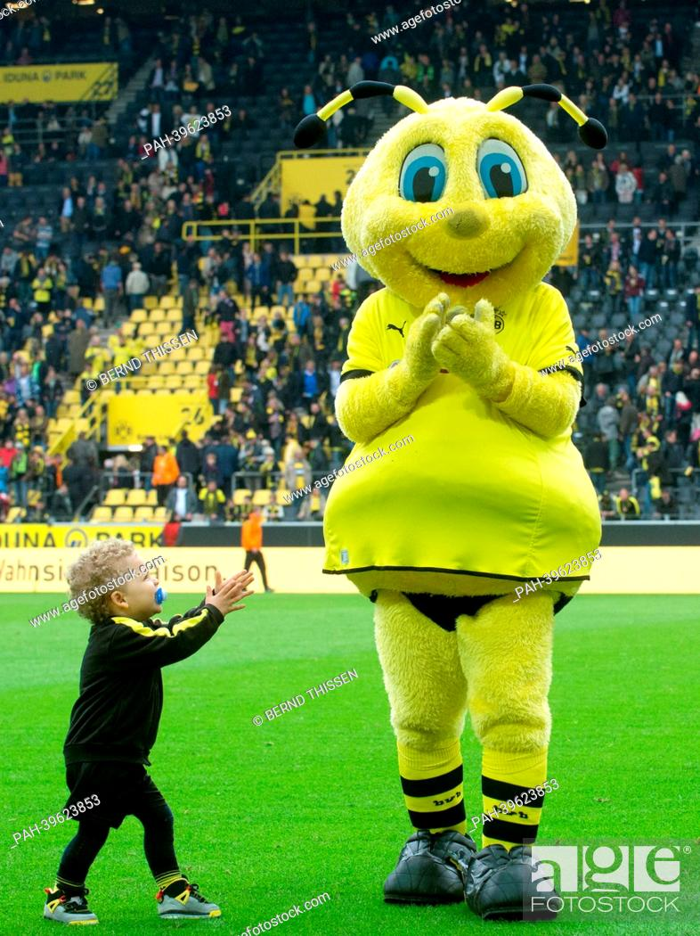 The Child Of Patrick Owomoyela L Walks To The Mascot Emma After The Bundesliga Soccer Match Stock Photo Picture And Rights Managed Image Pic Pah 39623853 Agefotostock