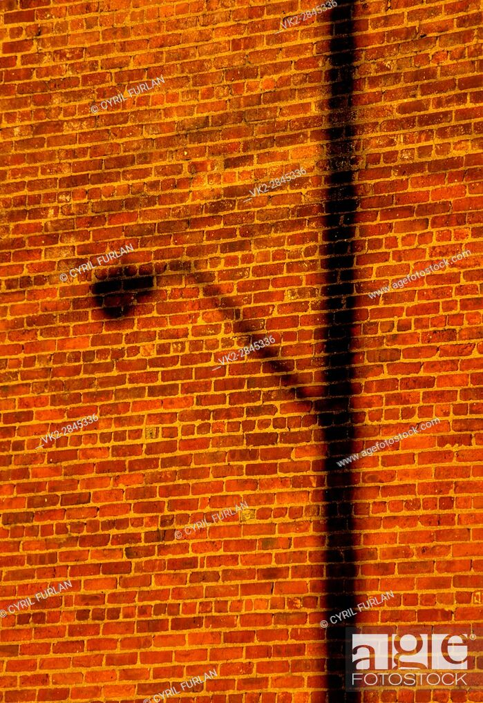 Stock Photo: Shadow of a street light on a brick wall in Brooklyn New York.