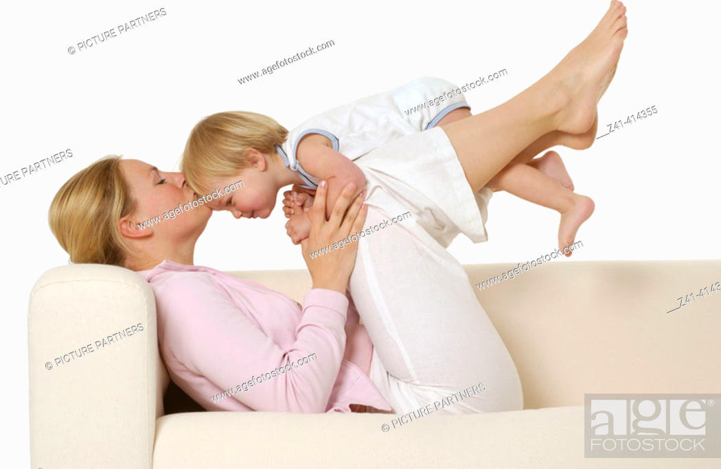 Stock Photo: Mother and toddler at a bench.