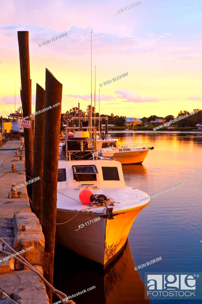 Stock Photo: Tarpon Springs, FL - Jul 2010 - Fishing boat along dock at Tarpon Springs, Florida.