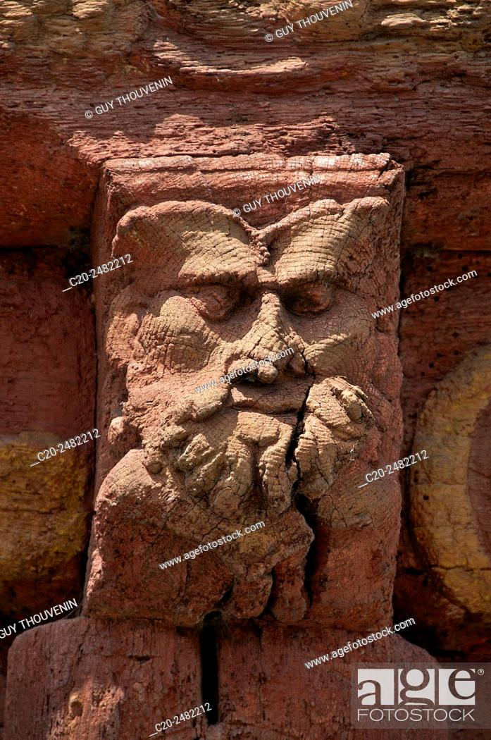 Stock Photo: Grotesque face carved in wooden beam, Henry IV house facade, Renaissance time, Saint Valery en Caux, Normandy , France.