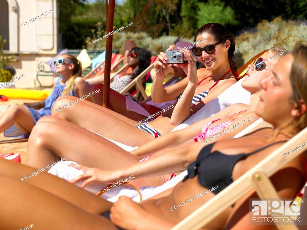 Stock Photo: People enjoying summer around the pool.