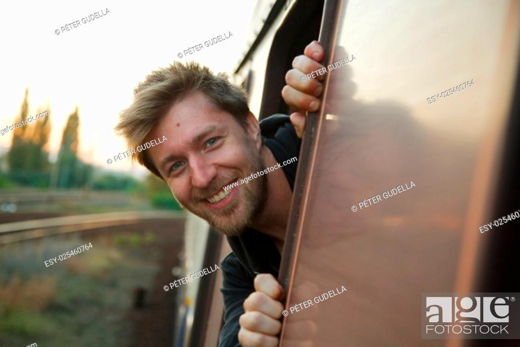Stock Photo: Enjoying ther ailroad journey in the window.