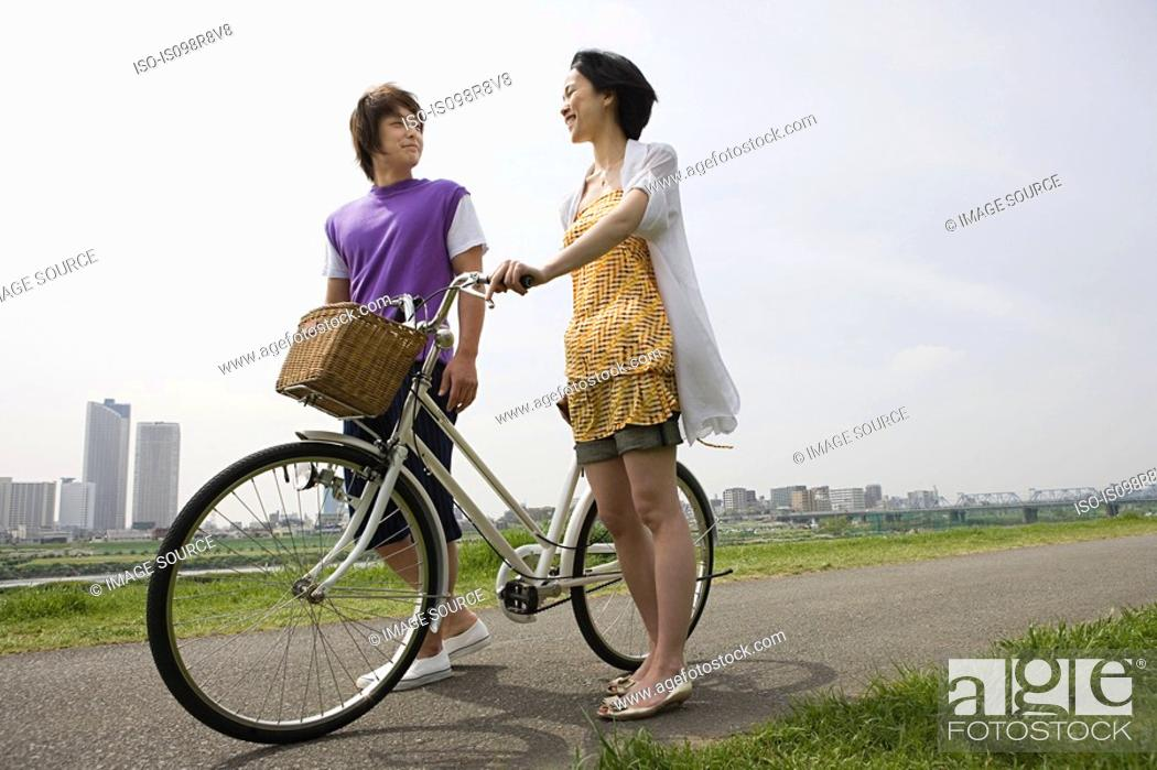 Stock Photo: Young couple with bicycle.