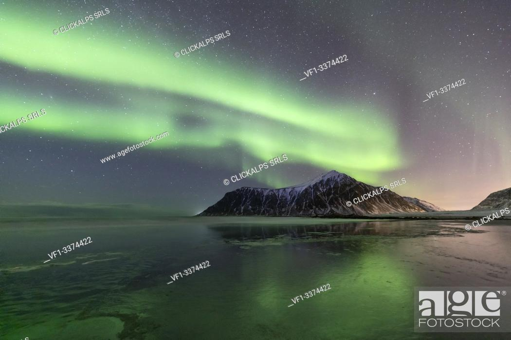 Stock Photo: A magical night whit Aurora borealis at Flakstad beach, Lofoten Islands, Northern Norway, Europe.