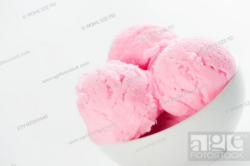 Stock Photo: Close up scoops strawberry ice cream in bowl with copy space on side, white background.