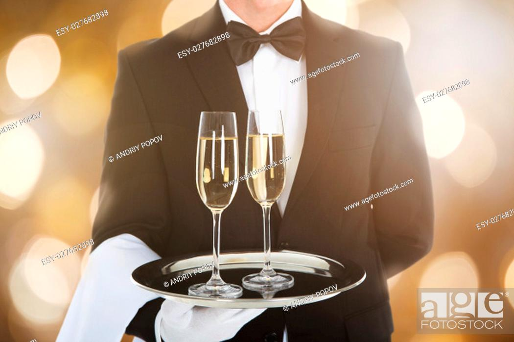Stock Photo: Close-up Of A Waiter Serving Glass Of Champagne In Tray.