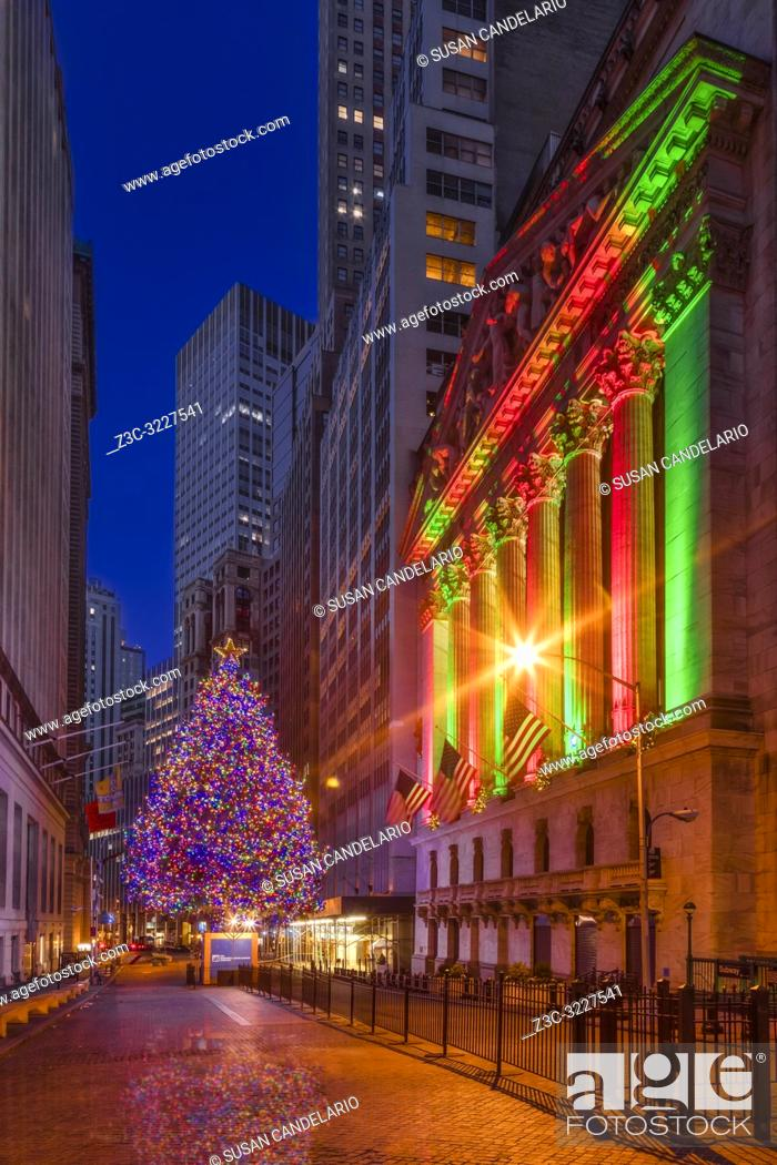 Stock Photo: New York City Stock Exchange Wall Street NYSE Xmas II - Wall Street in the Financial District in lower Manhattan in NYC with its 93rd annual Christmas tree.