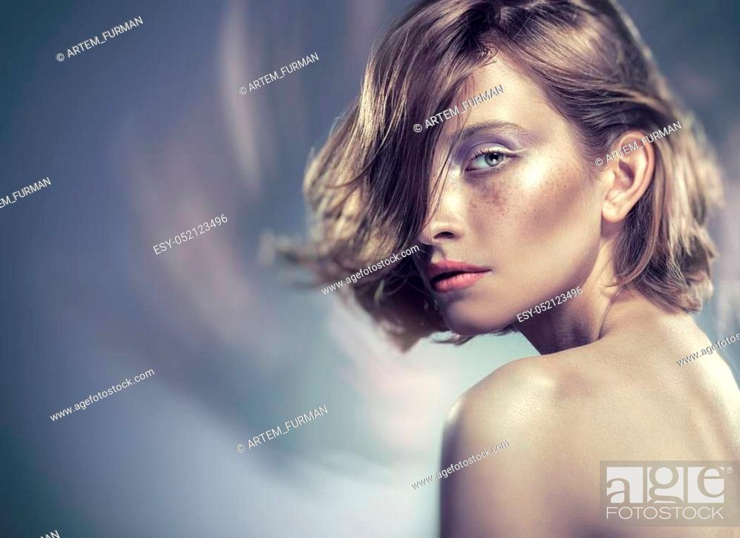 Stock Photo: Portrait of a beautiful sexy woman with natural makeup. Glamour picture.