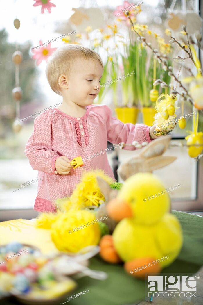 Stock Photo: Little Girl Playing With Easter Decoration, Osijek, Croatia, Euope.