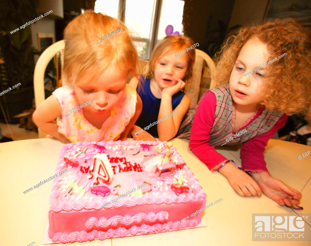 Stock Photo: Girl Blowing Out Candles On Birthday Cake.