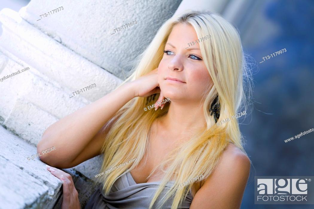 Stock Photo: Daydreaming young woman with beautiful Blue eyes.