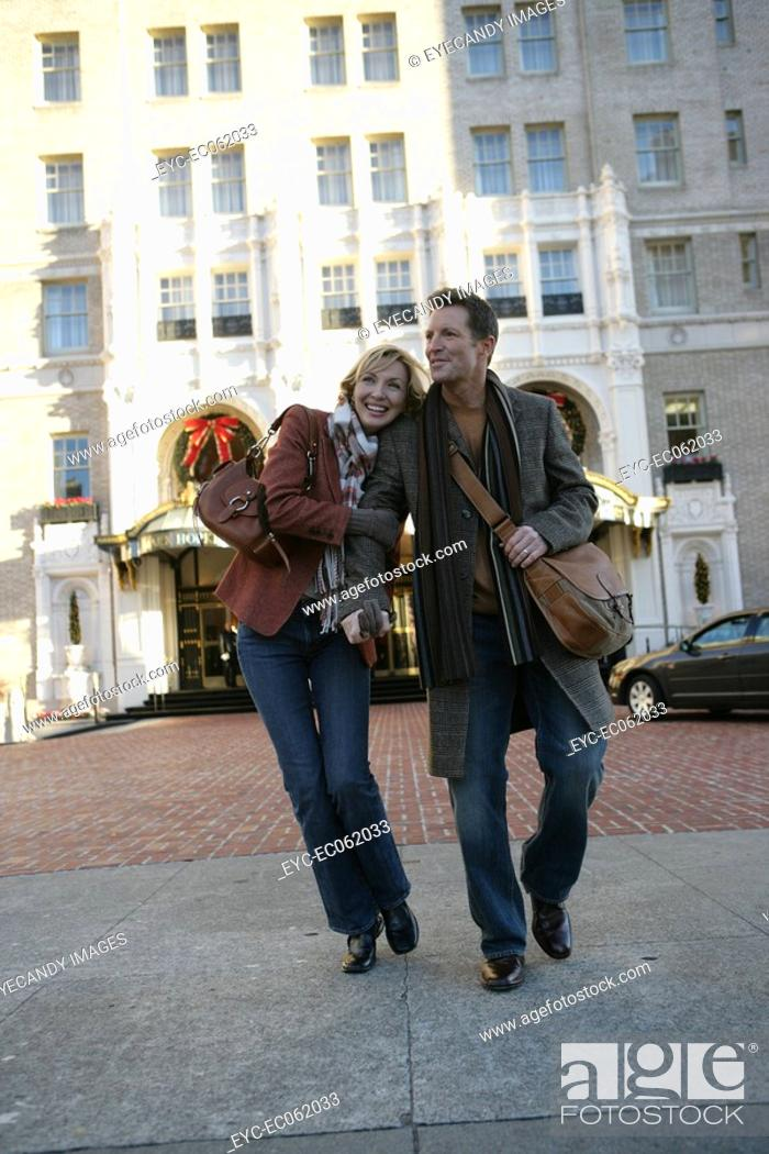 Stock Photo: Mature couple walking outdoors.