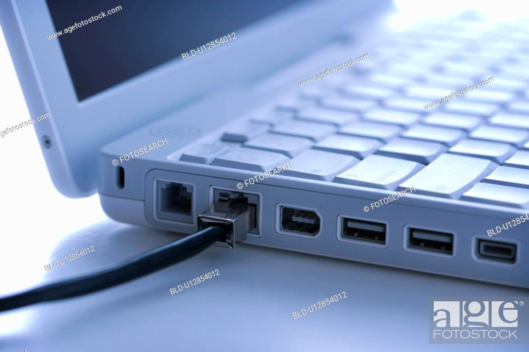 Stock Photo: Data wire connected to laptop.