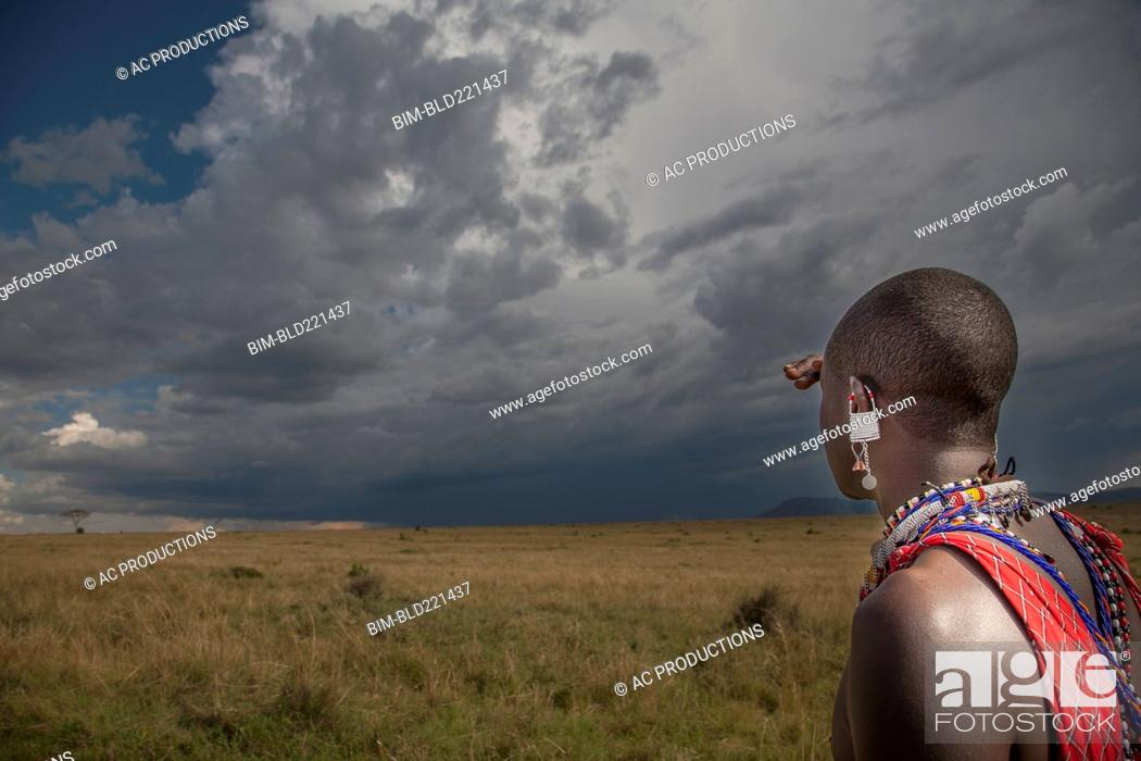 Stock Photo: Black man in traditional clothing admiring view.