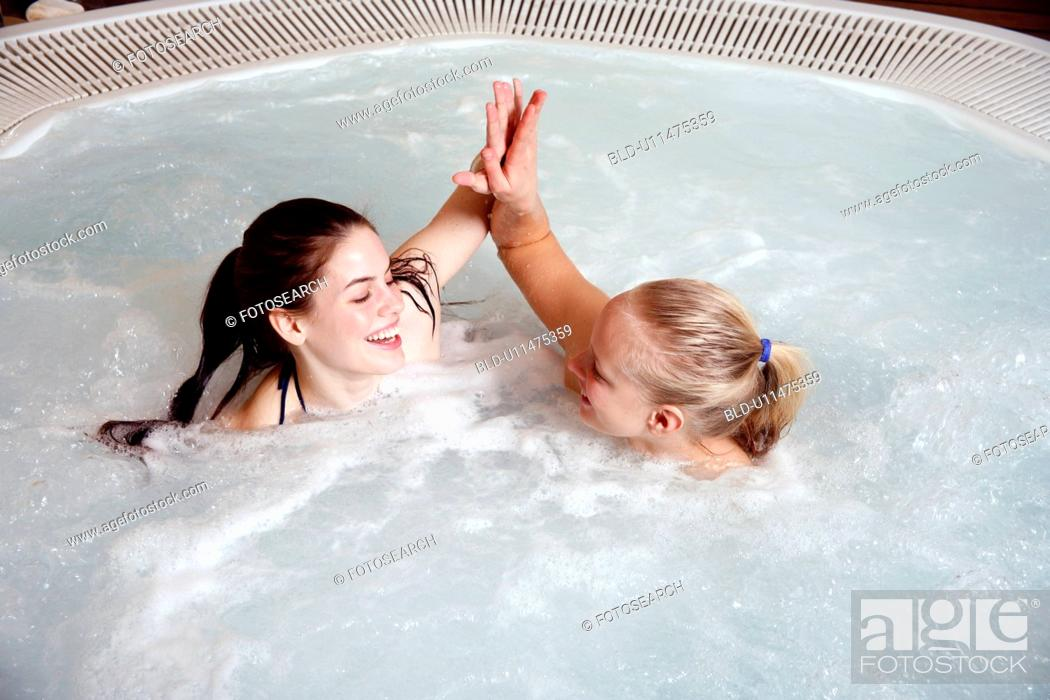 Stock Photo: Two young women in jacuzzi at a spa.