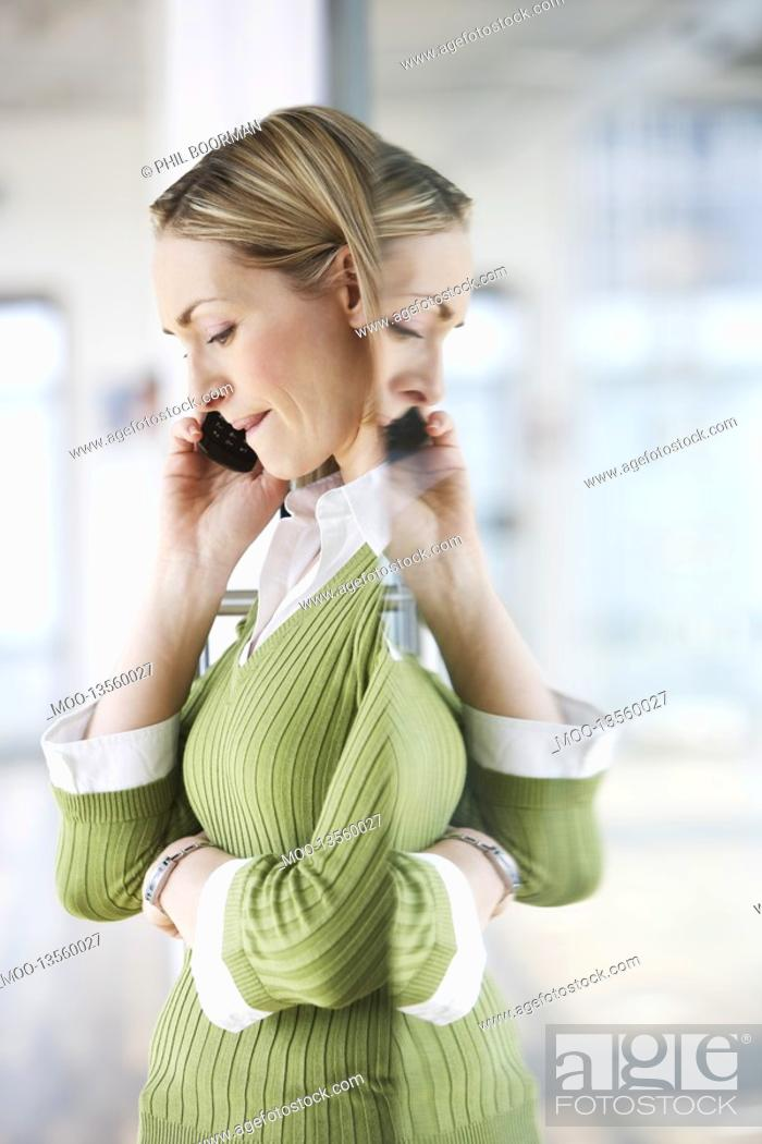 Stock Photo: Business woman using mobile phone in office.