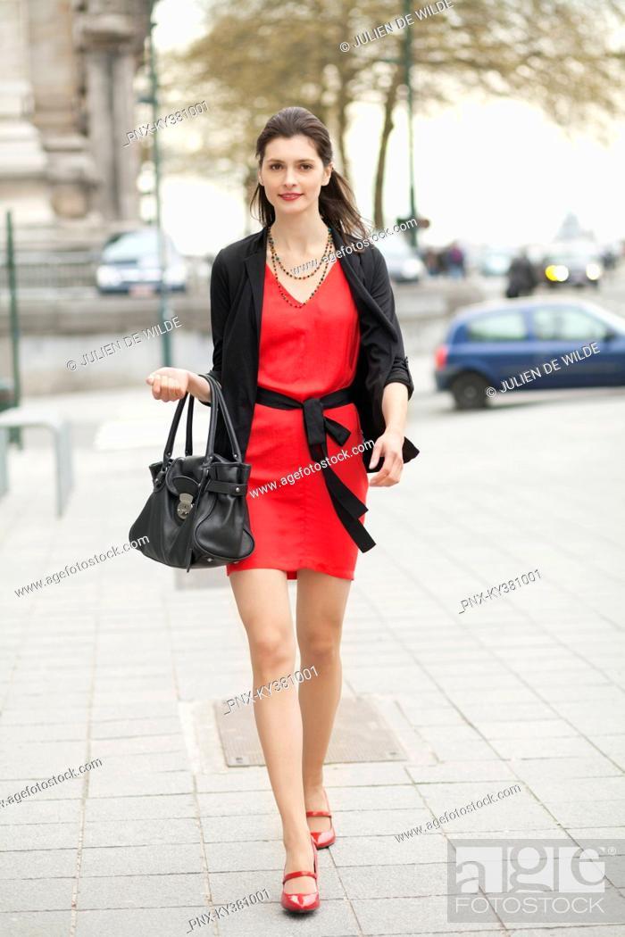 Stock Photo: Woman walking on street.