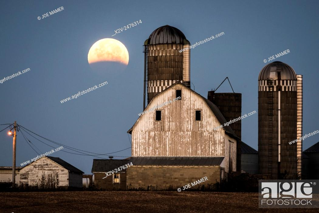 Stock Photo: Lunar eclipse over farm buildings near Shakopee, Minnesota.