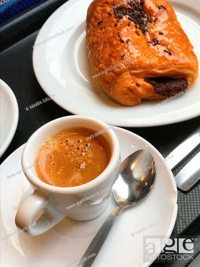 Stock Photo: Cup of coffee and napolitana.